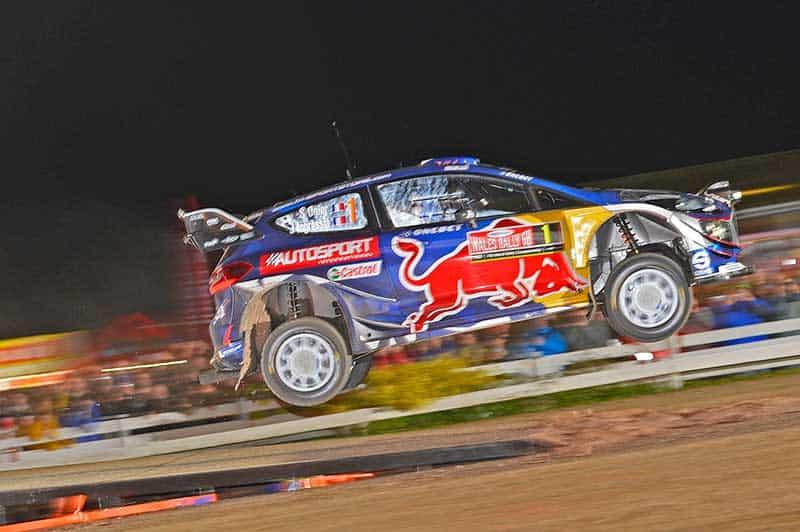 Sebastien Ogier jumps his Ford Fiesta WRC.